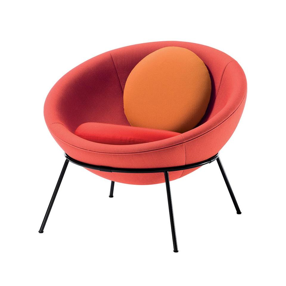 """<p>Made from an upholstered shell that sits in a ring-shaped frame, which can be adjusted by hand into an upright or reclining position, Lina Bo Bardi's 'Bowl Chair' was made in 1951 for the designer's own home, Casa de Vidro (Glass House), on the outskirts of São Paulo, Brazil. An iconic design, it's now reissued by Italian firm Arper. £4,610, <a href=""""https://www.arper.com/ww/en/"""" rel=""""nofollow noopener"""" target=""""_blank"""" data-ylk=""""slk:arper.com"""" class=""""link rapid-noclick-resp"""">arper.com</a></p>"""