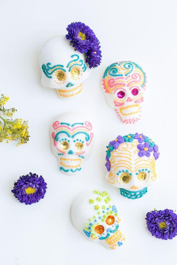 """<p>The holiday is traditionally all about honoring loved ones who have passed. Select party décor that commemorates the dead, like traditional sugar skulls, bright floral displays, and candlelit lighting. </p><p><em>Get the tutorial at <a href=""""https://sugarandcharm.com/how-to-make-mexican-sugar-skulls"""" rel=""""nofollow noopener"""" target=""""_blank"""" data-ylk=""""slk:Sugar And Charm."""" class=""""link rapid-noclick-resp""""> Sugar And Charm.</a></em></p><p><a class=""""link rapid-noclick-resp"""" href=""""https://www.amazon.com/Hyoola-White-Prayer-Candles-Pack/dp/B07RN2HX4Y?tag=syn-yahoo-20&ascsubtag=%5Bartid%7C10072.g.28787574%5Bsrc%7Cyahoo-us"""" rel=""""nofollow noopener"""" target=""""_blank"""" data-ylk=""""slk:SHOP PRAYER CANDLES"""">SHOP PRAYER CANDLES</a></p>"""