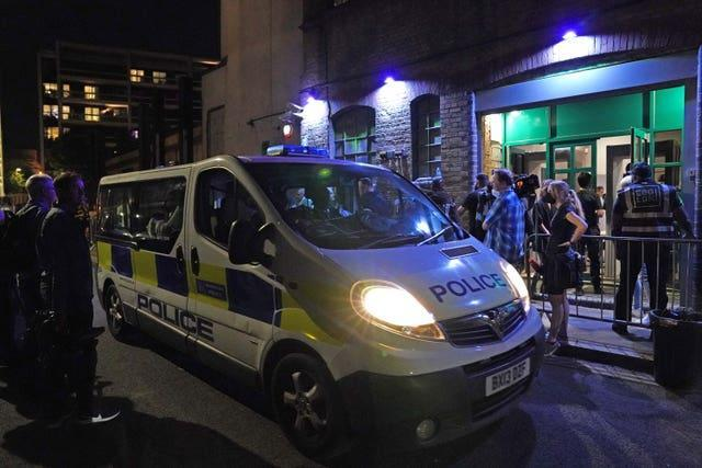 A police van outside the Egg nightclub in London as police talk to security