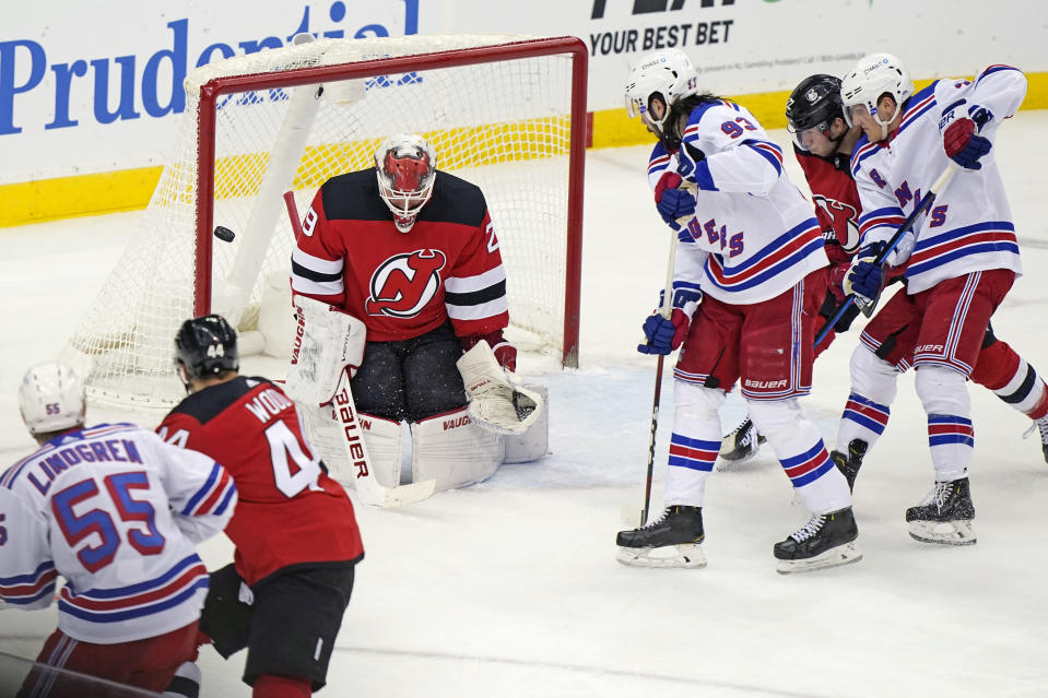 New Jersey Devils goaltender Mackenzie Blackwood (29) makes a save with multiple New York Rangers in front of the net during the second period of an NHL hockey game, Tuesday, April 13, 2021, in Newark, N.J. (AP Photo/Kathy Willens)