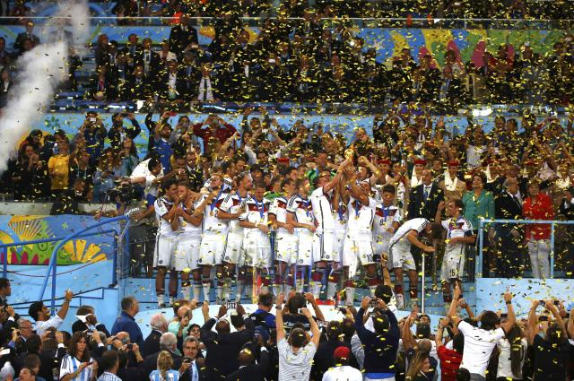 Germany players celebrate with their medals after winning the 2014 World Cup final between Germany and Argentina at the Maracana stadium in Rio de Janeiro July 13, 2014. REUTERS/Darren Staples (BRAZIL - Tags: TPX IMAGES OF THE DAY SOCCER SPORT WORLD CUP)