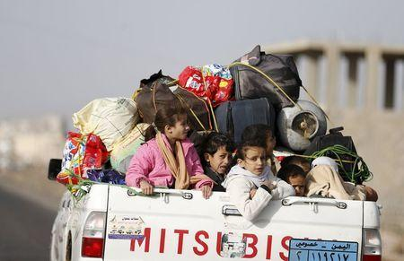 Children ride on the back of a pick-up truck with their luggage as they flee Saudi-led air strikes in Sanaa, Yemen, April 6, 2015. REUTERS/Khaled Abdullah