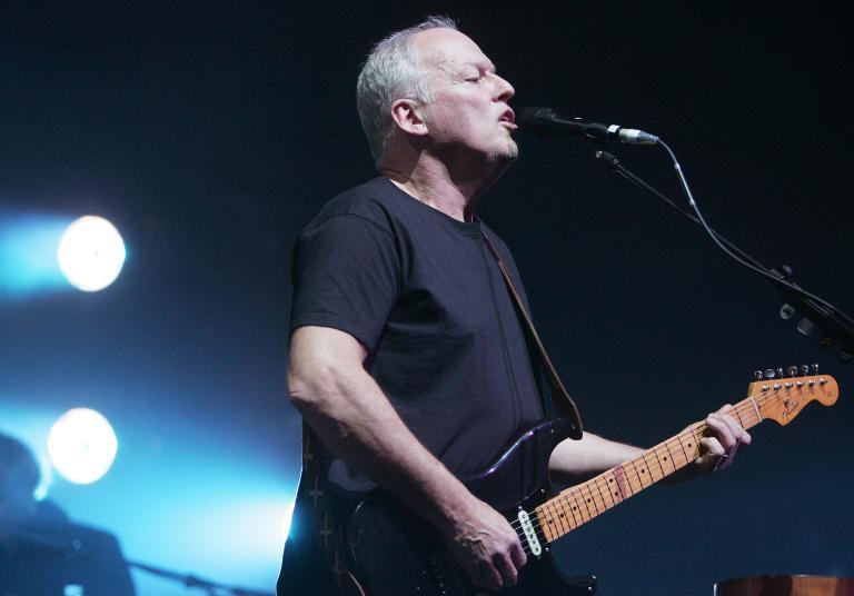 Months after rock legends Pink Floyd put out a final album, guitarist and vocalist David Gilmour, seen here perforimg in Paris March 15, 2006, is planning a solo album and shows at Roman-era theaters
