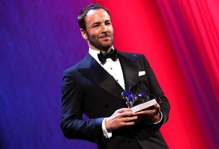 "Director Tom Ford holds the runner-up Grand Jury prize for the movie ""Nocturnal Animals"" during the awards ceremony at the 73rd Venice Film Festival in Venice"