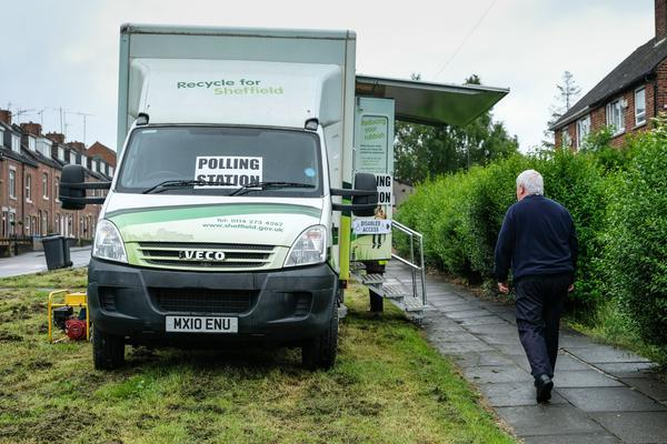 <p>This recycling van in Sheffield is also serving a democratic purpose (Picture: PA) </p>