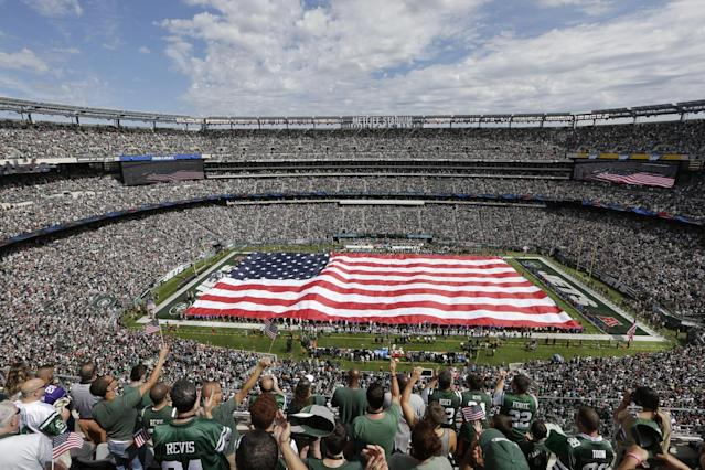 <p>Fans cheer during the playing of the national anthem before an NFL football game between the New York Jets and the Cincinnati Bengals Sunday, Sept. 11, 2016 in East Rutherford, N.J. (AP Photo/Frank Franklin II) </p>