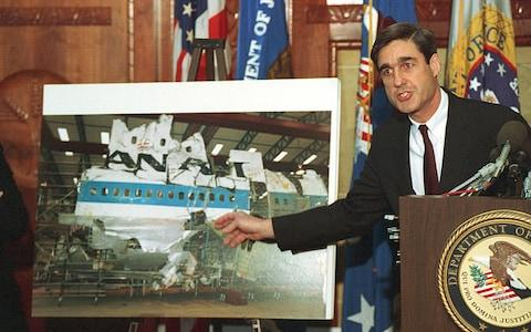 Robert Mueller points to a photo of the reconstructed wreckage of Pan Am Flight 103, which exploded over Lockerbie Scotland in 1988 - Credit: AP