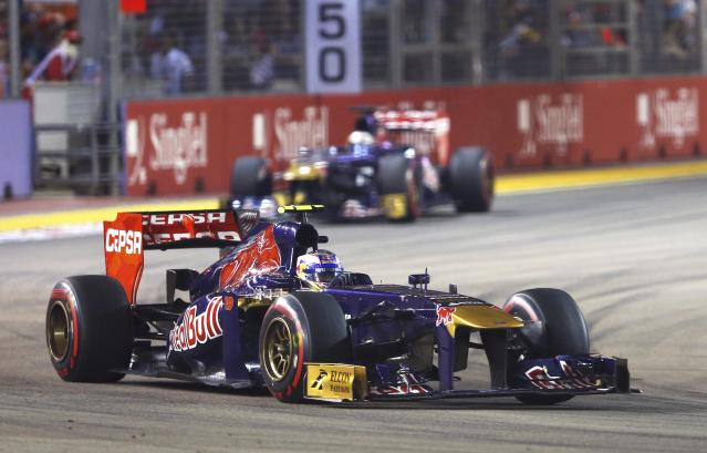 Toro Rosso Formula One driver Daniel Ricciardo of Australia leads team mate Toro Rosso Formula One driver Jean-Eric Vergne of France during the Singapore F1 Grand Prix at the Marina Bay street circuit in Singapore September 22, 2013. REUTERS/Edgar Su (SINGAPORE - Tags: SPORT MOTORSPORT F1)