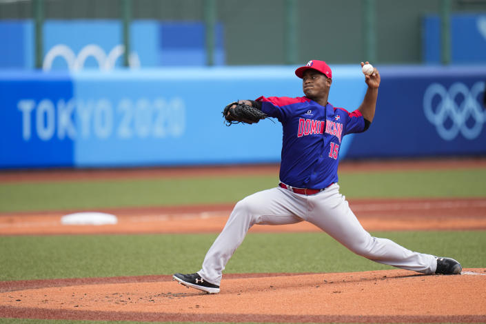 Dominican Republic starting pitcher Cristopher Mercedes throws against Japan during the first inning of a baseball game at the 2020 Summer Olympics, Wednesday, July 28, 2021, in Fukushima, Japan. (AP Photo/Jae C. Hong)
