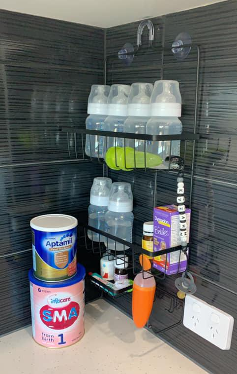The mum-of-two revealed she uses a $9 shower caddy from Kmart to store her baby bottles, saving a lot of space in the kitchen. Photo: Supplied