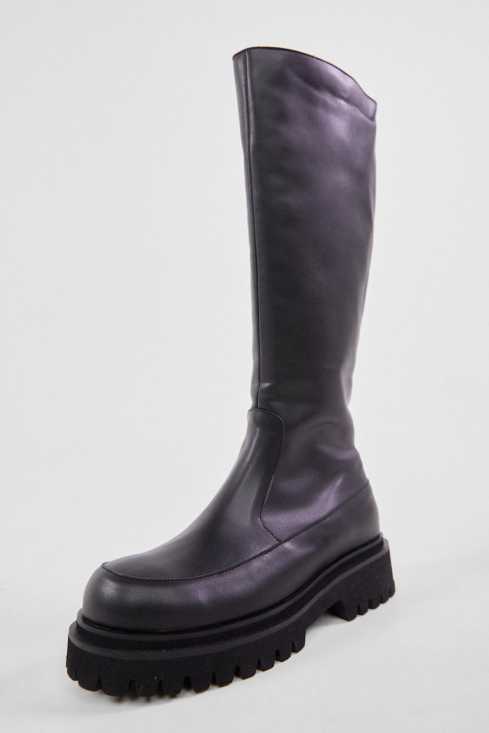"""<br><br><strong>The Source Unknown</strong> Lug Sole Tall Boots, Black, $, available at <a href=""""https://go.skimresources.com/?id=30283X879131&url=https%3A%2F%2Fthesourceunknown.com%2Fcollections%2Fshoes-bags%2Fproducts%2Flug-sole-tall-boots-black"""" rel=""""nofollow noopener"""" target=""""_blank"""" data-ylk=""""slk:The Source Unknown"""" class=""""link rapid-noclick-resp"""">The Source Unknown</a>"""