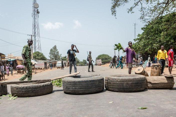 Protesters use tires to barricade the road in Toui, an opposition stronghold, on 7 April.