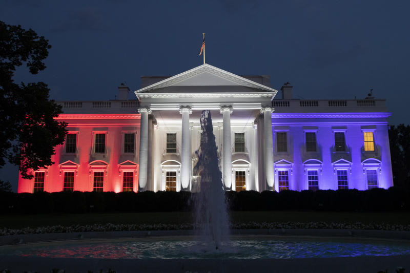 "The White House is illuminated with red, white and blue lights during a ""Salute to America"" event Saturday, July 4, 2020, in Washington. (AP Photo/Alex Brandon)"
