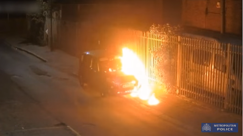 Arsonist appears to almost set himself alight as he torches stolen car