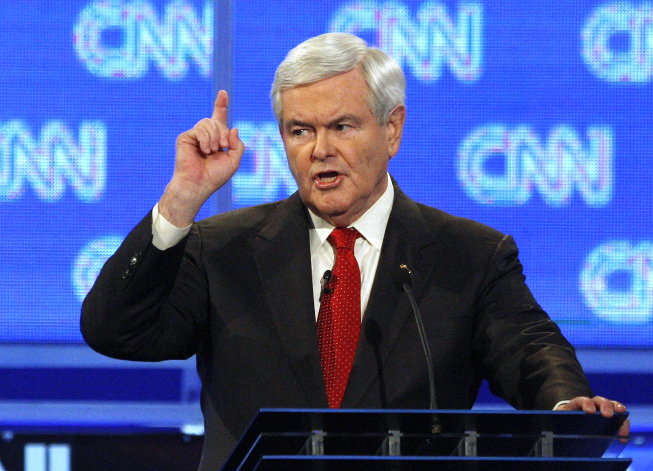 Former House Speaker Newt Gingrich scolds CNN moderator John King at the beginning of a Republican presidential candidates debate in Charleston, South Carolina, January 19, 2012. REUTERS/Jason Reed (UNITED STATES  - Tags: POLITICS ELECTIONS)