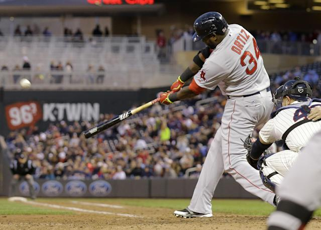 Boston Red Sox designated hitter David Ortiz hits a solo home run off Minnesota Twins relief pitcher Caleb Thielbar during the fifth inning of a baseball game in Minneapolis, Wednesday, May 14, 2014. (AP Photo/Ann Heisenfelt)