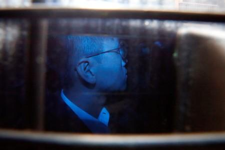 Activist Leung leaves the High Court in a prison van as he appeals against conviction and sentence, in Hong Kong