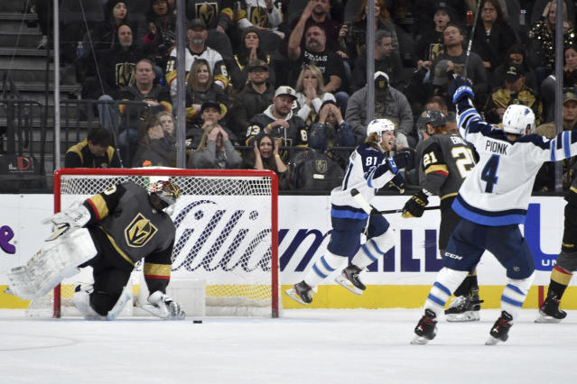 Vegas Golden Knights goaltender Malcolm Subban (30) looks on after Winnipeg Jets left wing Kyle Connor (81) scored the winning goal during the overtime in an NHL hockey game Saturday, Nov. 2, 2019, in Las Vegas. (AP Photo/David Becker)