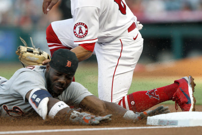 Detroit Tigers' Akil Baddoo, below, is tagged out at third by Los Angeles Angels third baseman Kean Wong while trying to stretch a double during the second inning of a baseball game in Anaheim, Calif., Thursday, June 17, 2021. (AP Photo/Alex Gallardo)