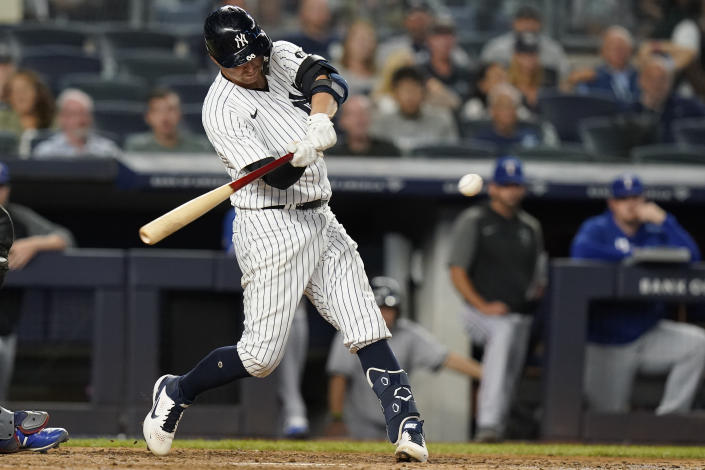 New York Yankees' Kyle Higashioka hits a two-run double during the fifth inning of a baseball game against the Texas Rangers Wednesday, Sept. 22, 2021, in New York. (AP Photo/Frank Franklin II)