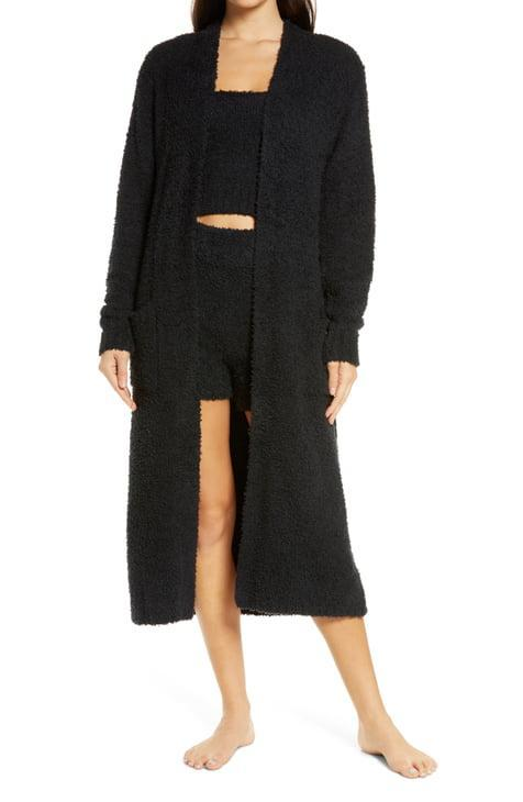 """Skims's drops just keep getting better and better, and right now we're living for this teddylike robe. Whoever finds this under the tree is guaranteed to wear it through next year. $128, Nordstrom. <a href=""""https://www.nordstrom.com/s/skims-cozy-knit-boucle-robe/5713993?"""" rel=""""nofollow noopener"""" target=""""_blank"""" data-ylk=""""slk:Get it now!"""" class=""""link rapid-noclick-resp"""">Get it now!</a>"""