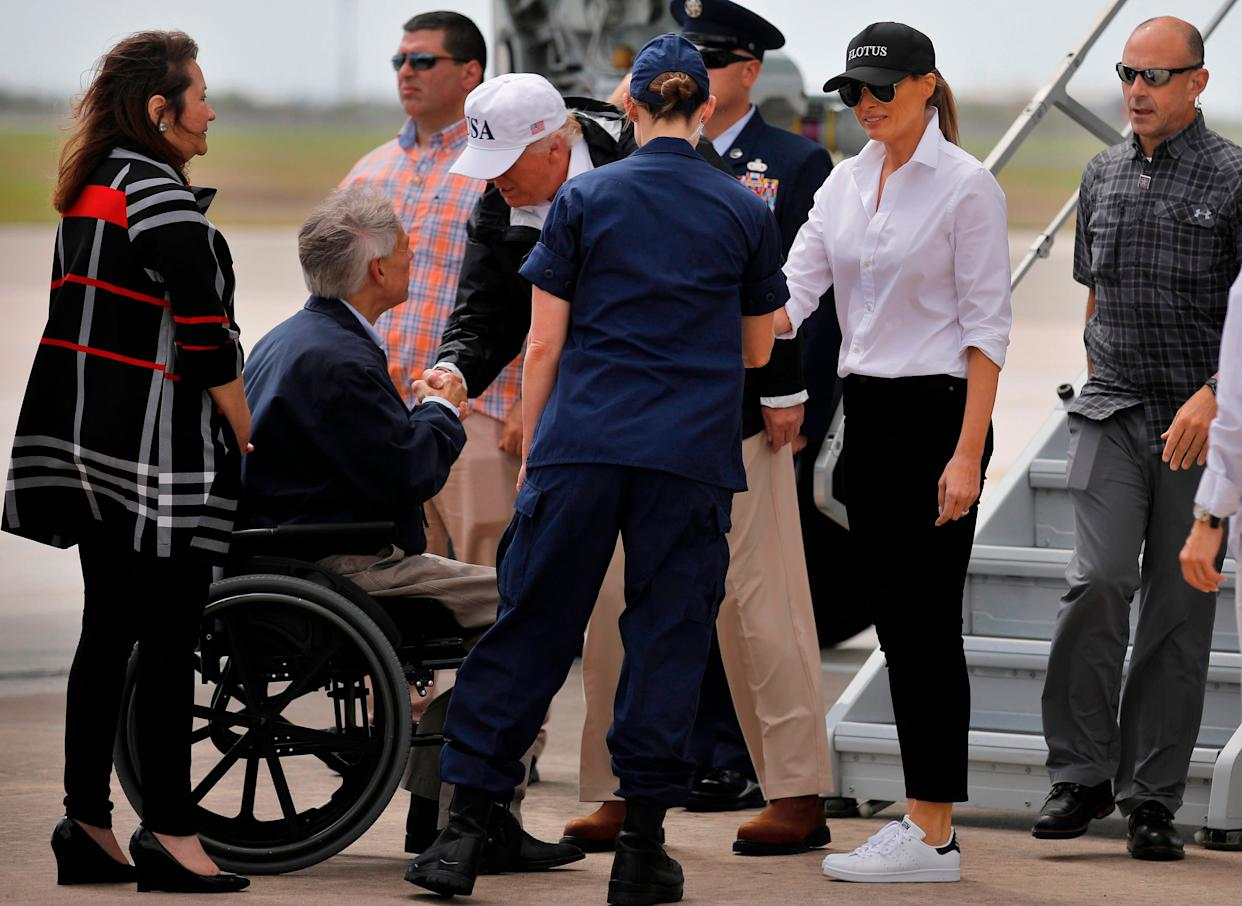 Trump and first lady Melania are greeted by Texas Governor Greg Abbott prior to receiving a briefing on Tropical Storm Harvey relief efforts in Corpus Christi.