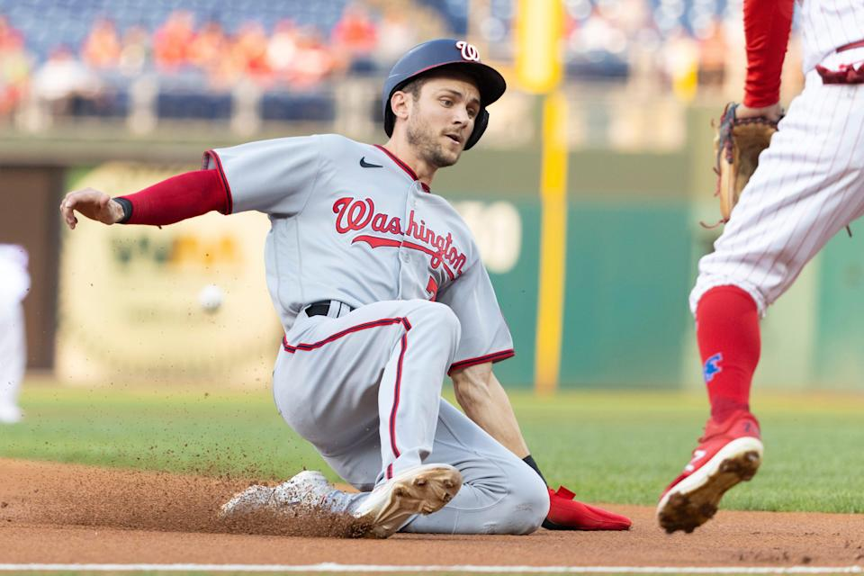 Trea Turner slides safely into third base in the top of the first inning against the Phillies in Tuesday's game at Citizens Bank Park.