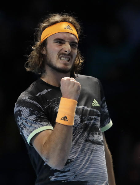 Stefanos Tsitsipas of Greece celebrates winning a point against Alexander Zverev of Germany during their ATP World Tour Finals singles tennis match at the O2 Arena in London, Wednesday, Nov. 13, 2019. (AP Photo/Kirsty Wigglesworth)