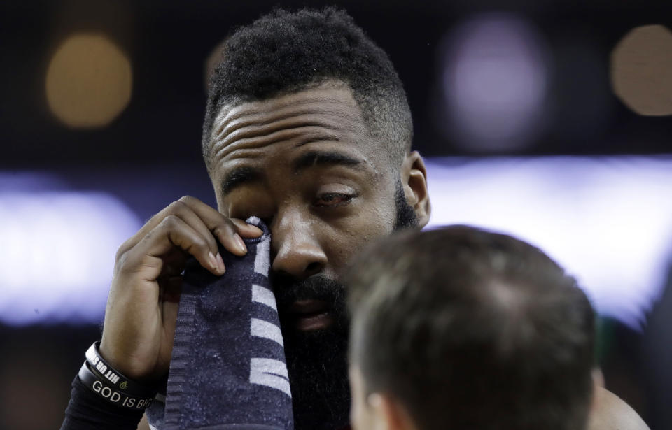 Houston Rockets' James Harden wipes his injured eye with a towel during the first half of Game 2 of the team's second-round NBA basketball playoff series against the Golden State Warriors in Oakland, Calif., Tuesday, April 30, 2019. (AP Photo/Jeff Chiu)