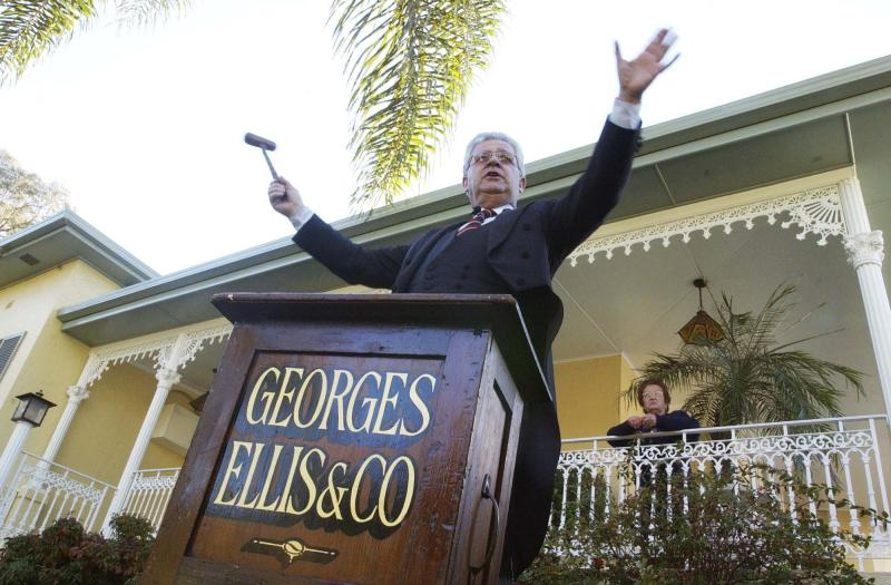 Roger Ellis of real-estate agents Georges Ellis and Co, starts the bidding at an auction for the sale of a four-bedroom family residence in the Sydney suburb of Strathfield.