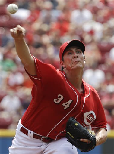 Cincinnati Reds starting pitcher Homer Bailey throws against the Pittsburgh Pirates in the first inning of a baseball game on Sunday, July 21, 2013, in Cincinnati. (AP Photo/Al Behrman)
