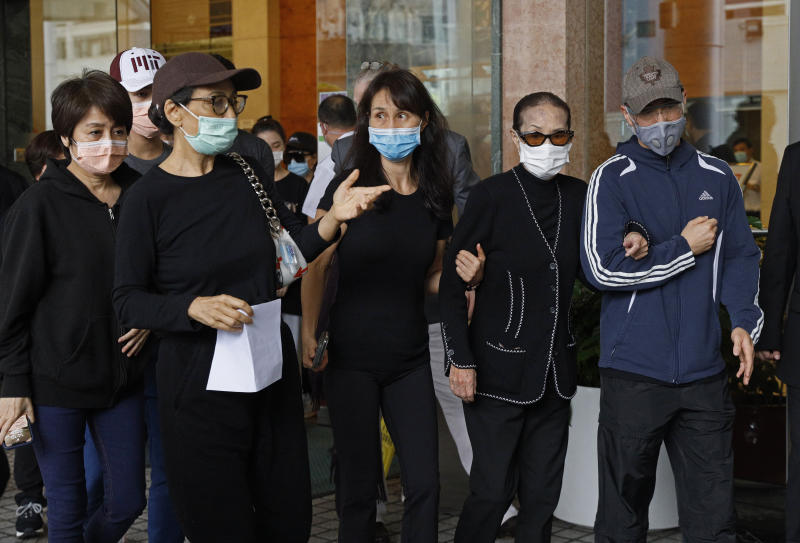 Family members of Macau tycoon Stanley Ho, including Angela Leong On-kei, left, walk out from a hospital, Hong Kong, Tuesday, May 26, 2020. Stanley Ho, the dashing billionaire and bon vivant who was considered the father of modern gambling in China, has died, his daughter Pansy Ho said Tuesday. He was 98. (AP Photo/Kin Cheung)