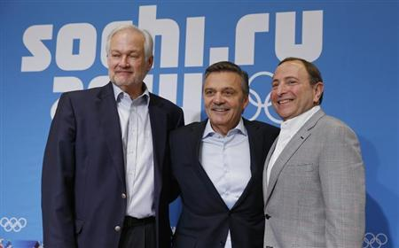 NHLPA Executive Director Fehr, IIHF President Fasel and NHL Commissioner Bettman pose for a picture after a joint news conference at 2014 Sochi Winter Olympics