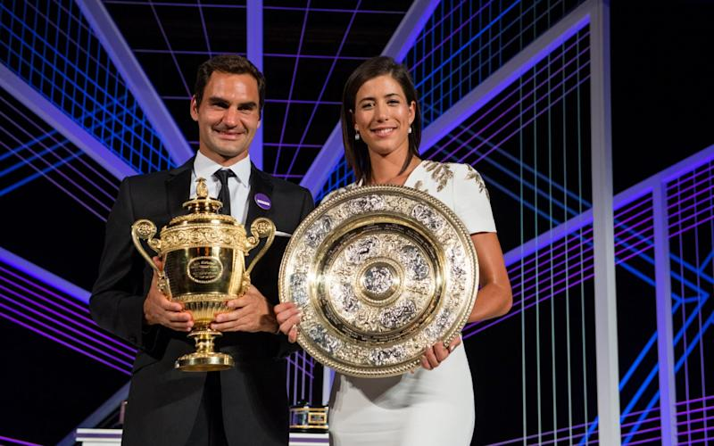 Federer with women's singles champion Garbine Muguruza - Credit: GETTY IMAGES