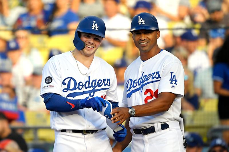 Los Angeles Dodgers' Gavin Lux, left, smiles as he stands with first base coach George Lombard after hitting a single during the second inning of a baseball game Monday, Sept. 2, 2019, in Los Angeles. (AP Photo/Mark J. Terrill)