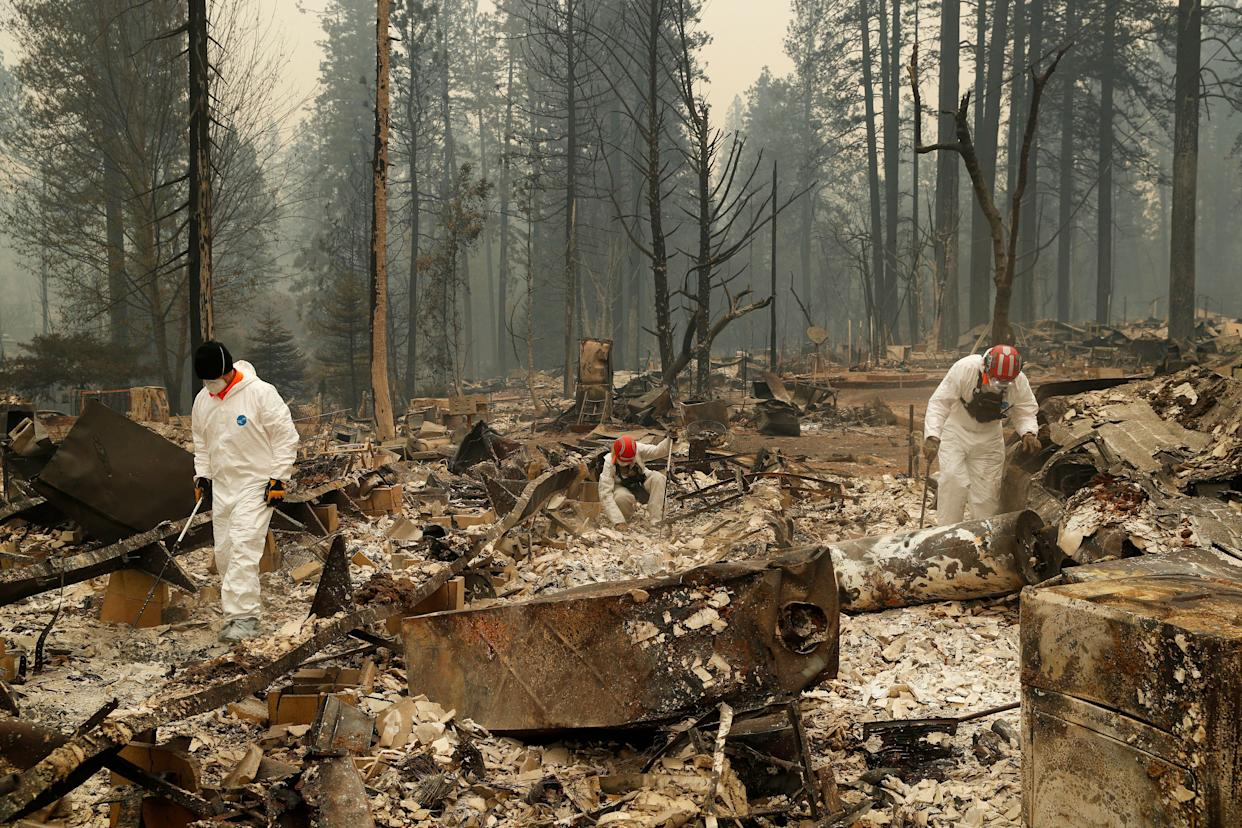 Search and rescue workers search for human remains at a trailer park burned in the Camp fire on Nov. 13, 2018, in Paradise, California. (Photo: ASSOCIATED PRESS)