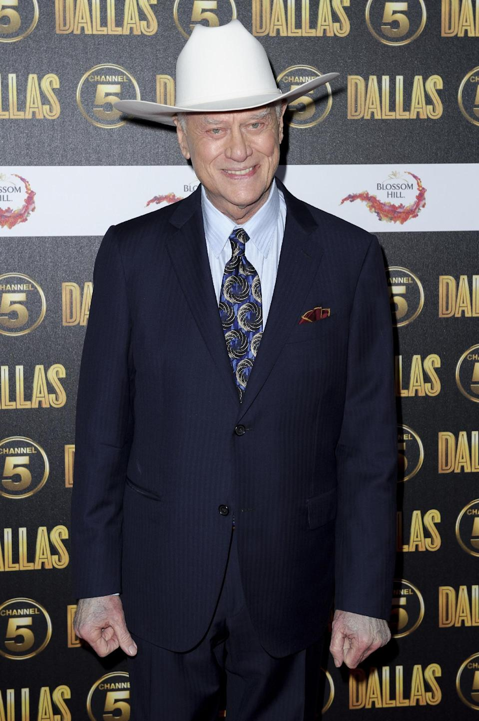 """FILE - In this Aug. 21, 2012 file photo, Larry Hagman arrives for the """"Dallas"""" launch party at a venue in central London. The Emmys will honor the late actors Hagman and Jack Klugman as part of an in memoriam package, but the two are not among those singled out for separate tributes. (AP Photo/Jonathan Short, File)"""