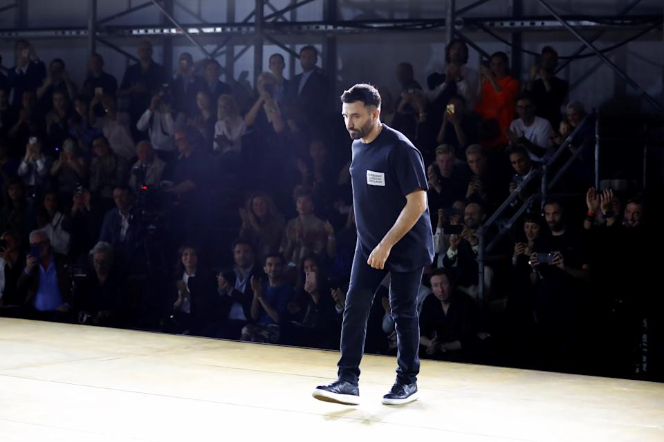 Burberry's Chief Creative Officer Riccardo Tisci takes a bow at the end of the Burberry SS20 show. [Photo Getty]