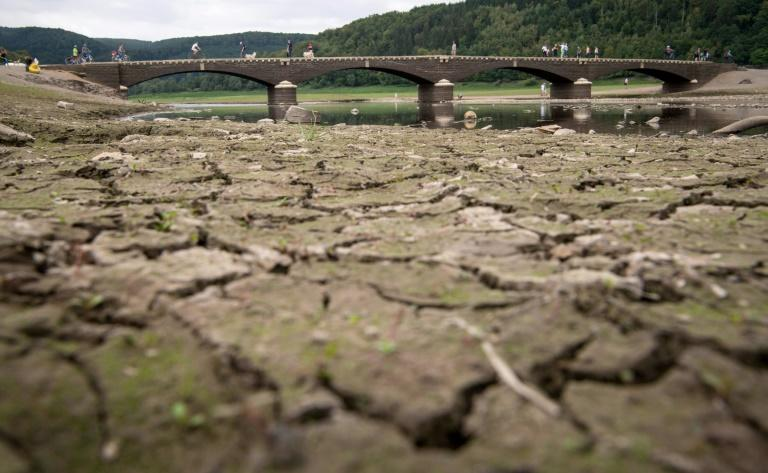 Pedestrians cross the Aseler Bridge over the partially dried out Edersee lake in Asel-Sued, in central Germany