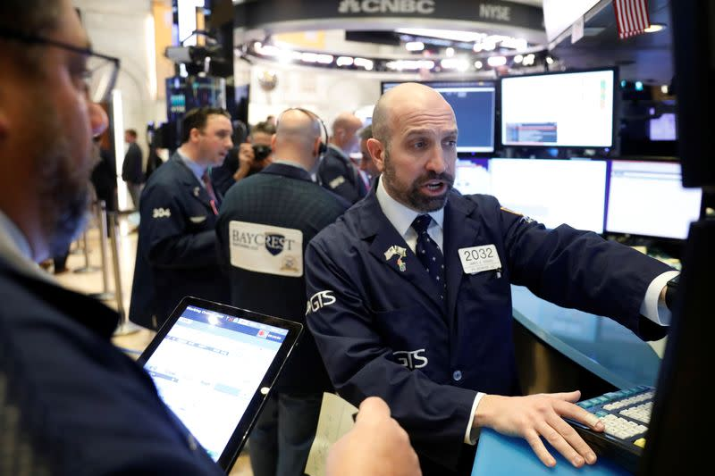 Wall St. falls more slowly as investors parse coronavirus fears