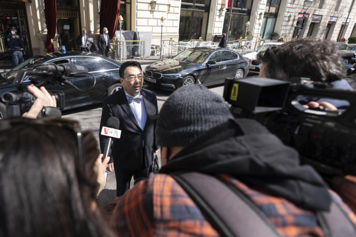 The ambassador of the Permanent Mission of the People's Republic of China to the United Nations, Wang Qun, addresses the media as he leaves the 'Grand Hotel Wien' where closed-door nuclear talks with Iran take place in Vienna, Austria, Friday, April 9, 2021. Diplomats meeting in Vienna assess progress of three days of talks aimed at bringing the United States back into the nuclear deal with Iran. (AP Photo/Florian Schroetter)