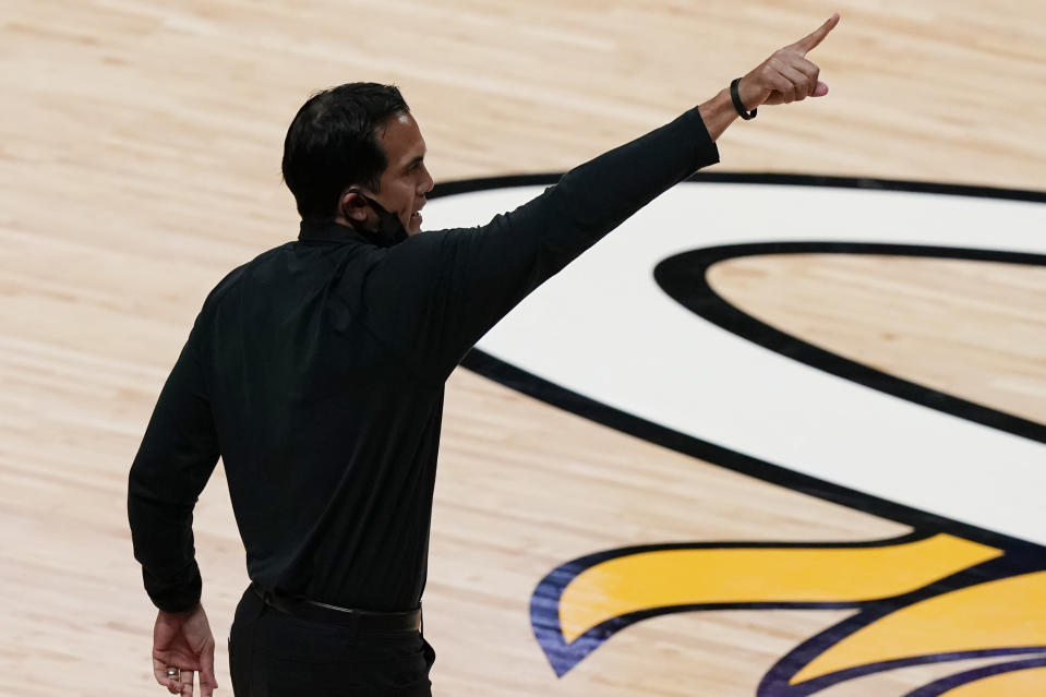 Miami Heat head coach Erik Spoelstra gestures during the second half of an NBA basketball game against the Houston Rockets, Monday, April 19, 2021, in Miami. (AP Photo/Marta Lavandier)