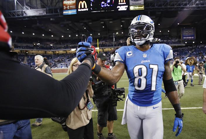 Detroit Lions wide receiver Calvin Johnson (81) is congratulated after an NFL football game against the Atlanta Falcons at Ford Field in Detroit, Saturday, Dec. 22, 2012. Johnson set the NFL record for single-season receiving yards. (AP Photo/Duane Burleson)