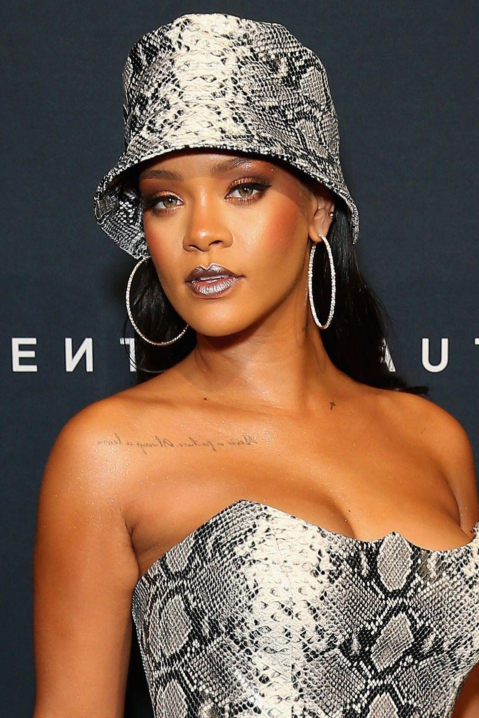 <p>Rihanna brought back bucket hats with this cool snake skin design.</p>