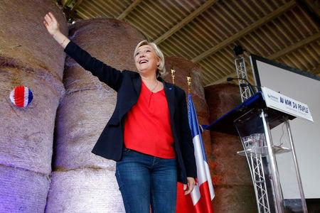 FILE PHOTO: Marine Le Pen, French National Front (FN) political party leader and candidate for the 2017 French presidential election, attends a meeting in a farm in La Trinite-Porhoet, France March 30, 2017. REUTERS/Stephane Mahe/File Photo