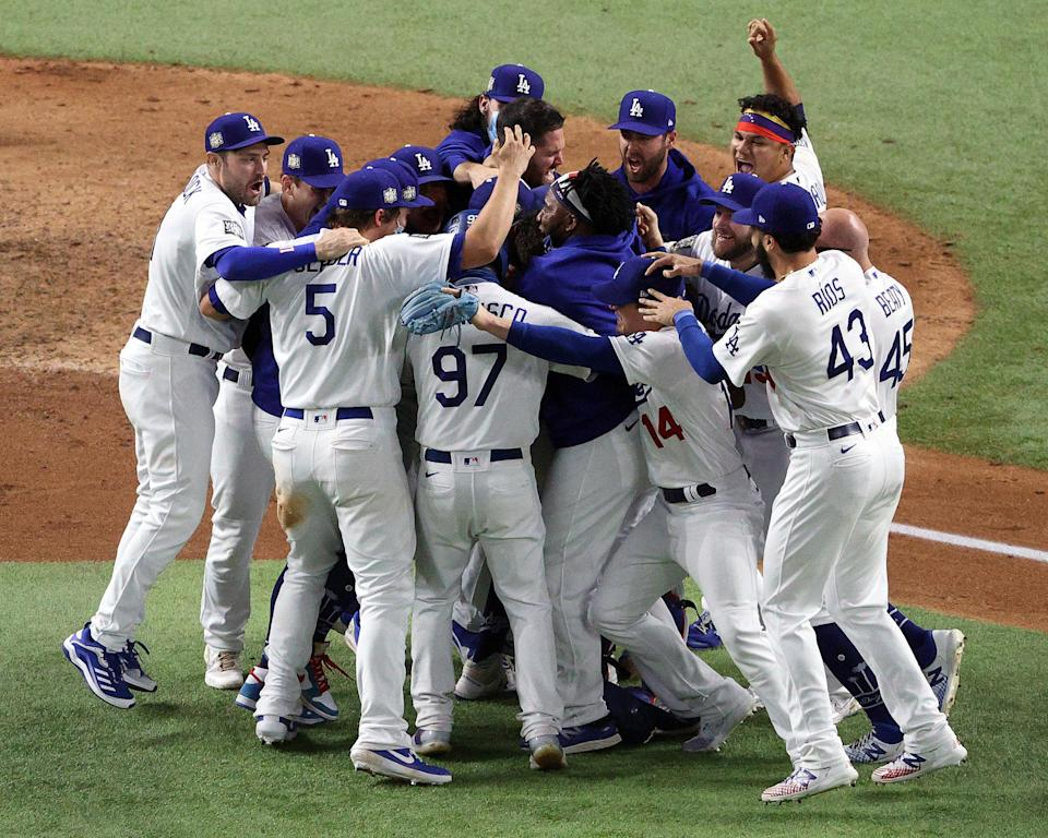 Image: The Los Angeles Dodgers celebrate after defeating the Tampa Bay Rays 3-1 in Game Six to win the 2020 MLB World Series at Globe Life Field (Sean M. Haffey / Getty Images)