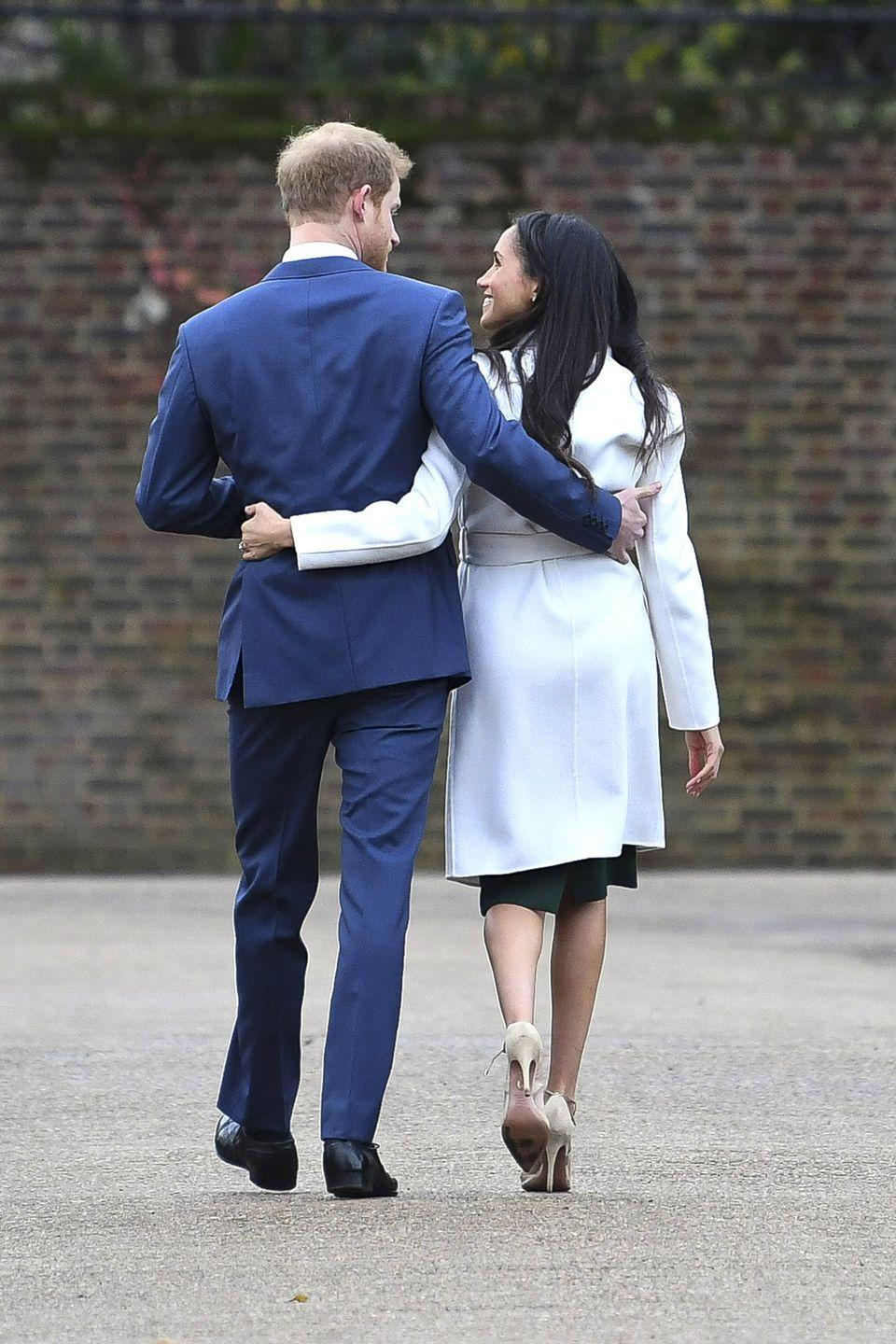 <p>Also on the happy engagement announcement afternoon, the couple shared a little PDA, wrapping their arms closely around each other as they strolled through the garden.</p>