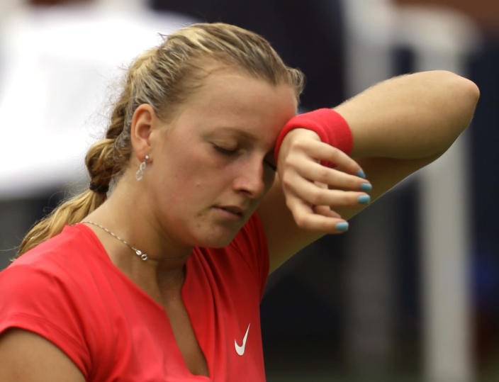 Petra Kvitova, of the Czech Republic, wipes sweat from her face between points against Alison Riske during the third round of the 2013 U.S. Open tennis tournament, Saturday, Aug. 31, 2013, in New York. (AP Photo/Julio Cortez)