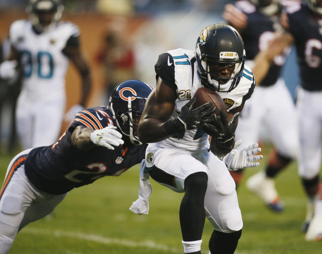 Jacksonville Jaguars wide receiver Marqise Lee (11) catches a 6-yard pass for a touchdown as Chicago Bears cornerback Kelvin Hayden (24) comes in from behind during the first half of an NFL preseason football game in Chicago, Thursday, Aug. 14, 2014. (AP Photo/Andrew Nelles)
