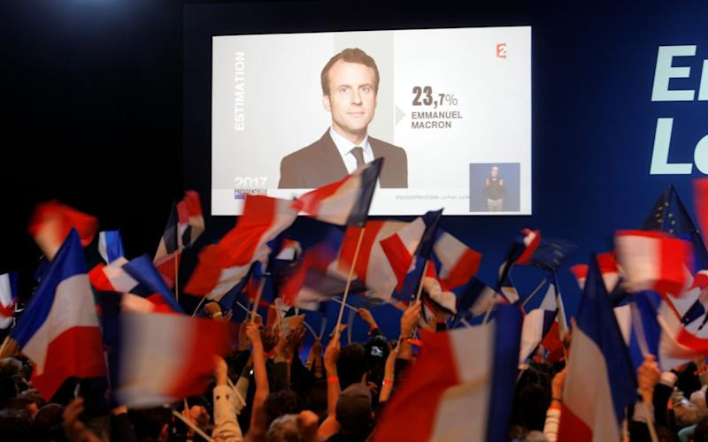 A screen announces the results of the first round of the French Presidential Elections naming Founder and Leader of the political movement 'En Marche !' Emmanuel Macron with 23.7 per cent of the vote at Parc des Expositions Porte de Versailles  - Credit: Sylvain Lefevre/Getty Images Europe